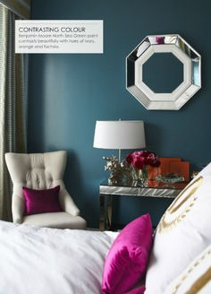 Suzie: Adore Magazine - Peacock blue teal walls paint color, mirrored console table, ivory ...