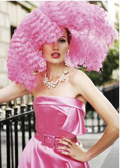 dior. so fabulous. big hot pink feather hat and pink satin dress