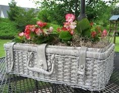cute idea for an old wicker suitcase