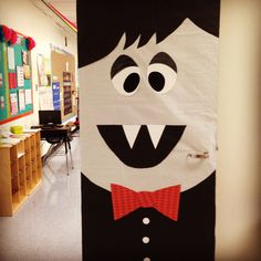 Students can cut (fine motor) out shapes (geometry) Halloween Door Decor- kindergarten