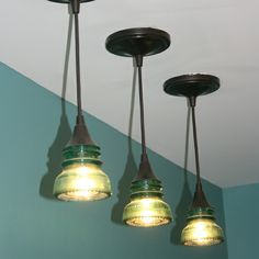 For a retro industrial look, this couple cut the tops off glass insulators and wired them with home center pendant kits. | thisoldhouse.com/yourTOH
