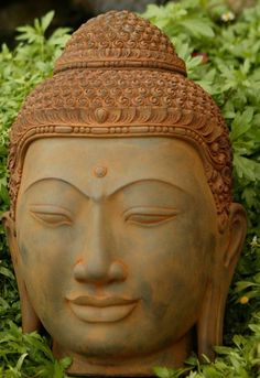 #Buddhist #art   #Buddha head in the garden