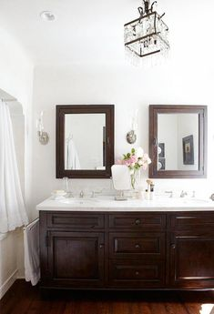 mahogany wood and white tile bathroom designed by Chris Barrett and photographed by Victoria Pearson
