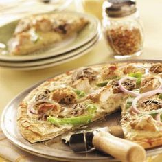 You'll love Chicken Alfredo Pizza that's loaded with toppings and bursting with flavor.