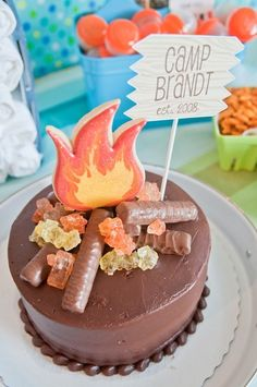 How clever is this campfire cake made with Twix bars and rock candy?