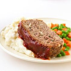 Meatloaf topped with a ketchup-based sauce.