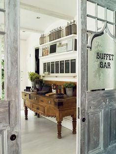 Love it all...The buffet table, the doors,the chalkboards, and those jars