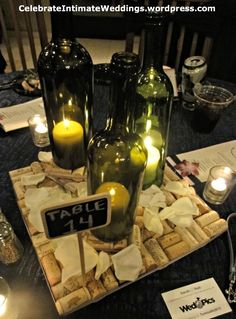 An attractive center piece... one that doesn't block the view so guests can see and talk to each other while they are eating at the reception.  The bottoms of the wine bottles are cut off and placed over the burning candles.  The candles can breath with air that circulates while resting on a few wine bottle corks.