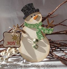 I keep looking for cute snowmen and this one by Handmade by Odette is great!