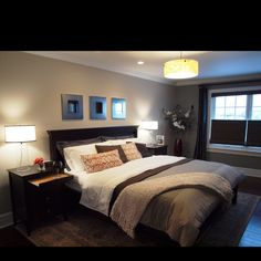 Cozy master bedroom. Really liking the dark wood.