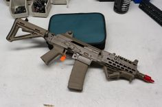 New Krebs Custom AK SBR - Built on a Russian made Saiga 5.56/.223 sporter.  Includes Krebs Keymod rail system, Definitive Arms AR15 mag well conversion, side-folding Magpul stock and pistol grip, AFG front grip, and a Cerakote finish.  Prototype, but this would be bad-ass if put into production.
