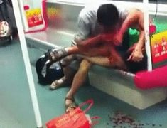 This happened in China: guy in white is chewing on the other guy's arm and leg; no one is helping because there's a law in China, that says the rescuer can be liable for medical bills of the person that was rescued. So instead everybody just stood and watched. (DB) GIF