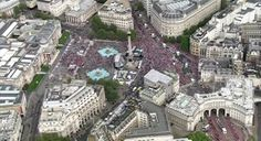 Packed city: An aerial view shows the crowds lining the streets of London