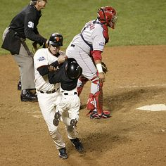 JT Snow Saves Darren Baker (batboy) from disaster since the play wasn't over as he wandered over to pick up the bat....