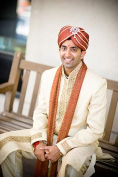 Indian groom in Indianapolis in sherwani with rust orange dupatta via IndianWeddingSite.com