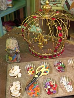 old muffin tin turned button/craft supply storage in the OFFICE OF Daydreams episode on HGTV! {junk gypsy co. - http://gypsyville.com/ }