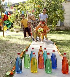 Backyard Bowling ~ Add a few drops of food coloring to ten clear plastic bottles of water. Stand them up on flat ground, use party streamers as lane margins... Break glowsticks in the bottles for lawn bowling at night... this is AWESOME!