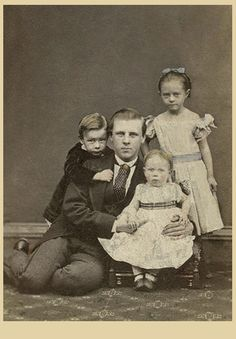 Beautiful portrait of a father and his three children.  The informal pose is unusual for that time period.  And yet it shows the love of this father who doesn't mind getting down on the floor with his little ones.  I love the way the boy is hugging his father from behind and the way the father is leaning into his girls, it displays such tenderness. Glasgow, Scotland.  ca. 1867