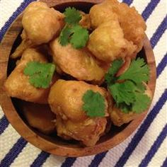 "Fried Cauliflower (Egyptian Style) | ""Cauliflower florets are coated in a cumin-scented batter and deep-fried for a crispy and Egyptian-inspired appetizer."""