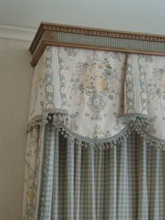 Very attractive valance with a molding frame above. Creative & oh so custom. The bell with scalloped edge, the fabrics & trim, just such attention to detail.