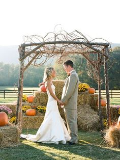 The backdrop of hay bales and pumpkins is beautiful!