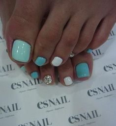 Cute toe polish for summer - various shades of the same color, and one glittered nail!