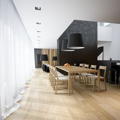 We also see the black base note of the furniture utilized as a feature wall color in this concept, with dark chunky dividing walls adding drama to the scheme.