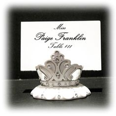 "Our beautifully designed Crown Placecard Holder is made of Resin with clear rhinestone accents. Each place card holder measures approx. 2 1/4"" x 1 1/4"".#weddingfavors"