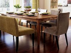 Love the upholstered bench at the dining table