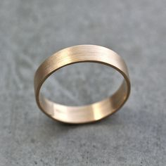 sly fox is an awesome vendor    Men's Gold Wedding Band, Unisex 5mm Wide Brushed Flat 10k Recycled Yellow Gold Wedding Ring Gold Ring -  Made in Your Size. $390.00, via Etsy.
