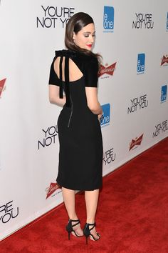 Emmy Rossum booty in a black dress on the red carpet