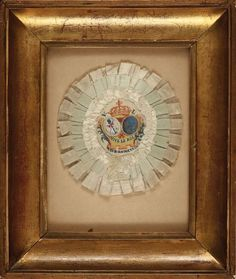 A cockade created for the Fête de la Fédération of 1790. This rare piece exhibits a combination of 'royal' and 'national' symbolism, such as featuring both 'Vive le Roi' and 'Vive le Nation' in its centerpiece.  source: Coutau-Begarie Auctions