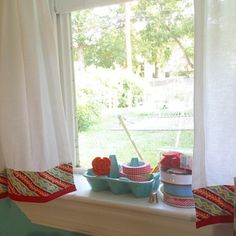 "My home studio features an ""At Home with Modern June"" pattern mass up! I used the trim detail from the bed skirt pattern to trick out the cafe curtain pattern. I like the punch of color that the two bias tapes add to the room. #aqua #red!! #modernjune #Instagram #sewingbook"