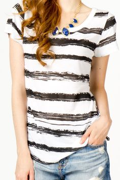painted stripes- i like the loose t-shirt and the fancy-ish necklace