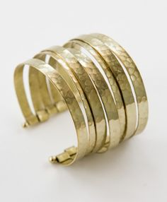 Create a complex look with one simple piece--layers of hammered brass stack to add rustic flair to your look.