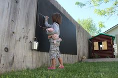 Cool DIY idea. Paint a large sheet of plywood with chalkboard paint and attach to the backyard fence. Give the kids a bucket of colored chalk for tons of art fun! - Project Denneler