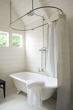 clawfoot tub + curtain