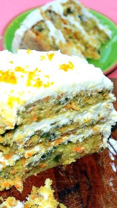 LOADED Caribbean CARROT CAKE with Pineapple Cream Cheese Frosting... And when I say loaded I mean it... Pineapple, Banana, Walnuts, Coconut and of course carrots!  The Pineapple Cream Cheese recipe is FANTASTIC, a great sweet topper to a fruit heavy dessert!  I LOVE this CAKE!