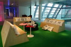 Scrabble Furniture, made by Stephen Reed for employees in the London offices of Bloomberg financial services.  Users can make words and leave messages with the screen printed letter cushions.