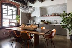 Love the tile and concrete floors in this kitchen! COCOCOZY: SMALL PORTLAND LOFT GETS BIG DESIGN