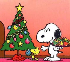 Snoopy and Woodstock preparing for the arrival of Santa Claus!