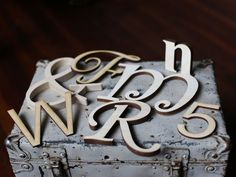 Unpainted wood letters and wood numbers in any font. Ampersands too!