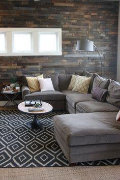 Wood Clad Wall, Grey Sectional Sofa, Kite Kilim Rug- west elm living Room