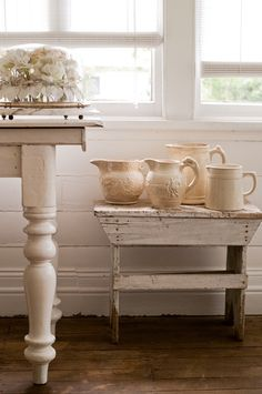 Chunky table leg and rustic white painted bench.