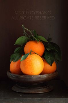 Valencia Oranges with Leaves by CY Phang - Oranges contain large quantities of Vitamins C and E, both of which are major sources of antioxidants and other collagen building nutrients. Face masks using orange are also good for everything from discolouration to acne.