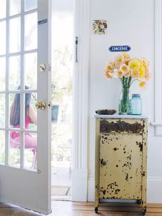 Just inside the front door, a weathered medical cabinet stores dog-walking essentials and welcomes guests with a fresh vase of flowers: http://www.bhg.com/decorating/decorating-style/flea-market/flea-market-cottage-style-decorating/?socsrc=bhgpin050214welcomehome&page=3