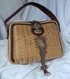 Sexy Steampunk wicker purse, silver leg, inner watch parts, leather handle and trim, vintage couture