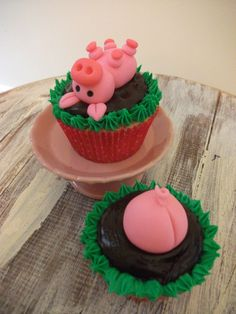 I can't imagine putting these on a cupcake, but I can see putting them on a bigger cake.  Cute little fondant piggies.