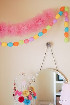 all things simple   tutorial for the simplest and prettiest tulle pom-poms + garland. Great resource for inexpensive tulle.