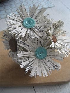 How to make fringed book page flowers.....I love the fringe and button center!